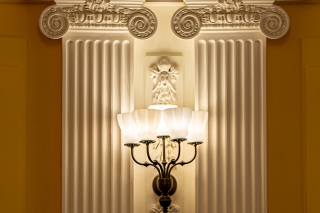 A closeup of pilasters and sconces in the Presidents' Room